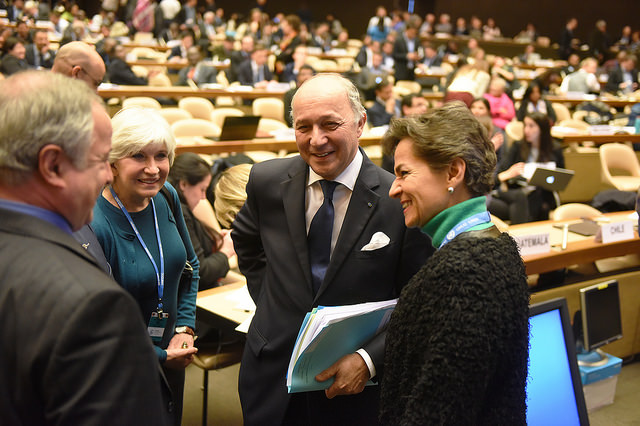 Two women and two men gather in a circle to talk during a UN meeting.