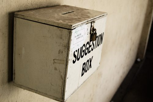Old box for submitting complaints nailed to a wall.