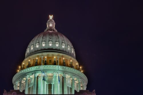 Top of the capitol building at night.
