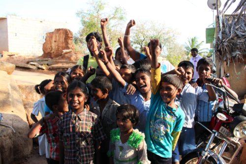 Happy children raising their fists