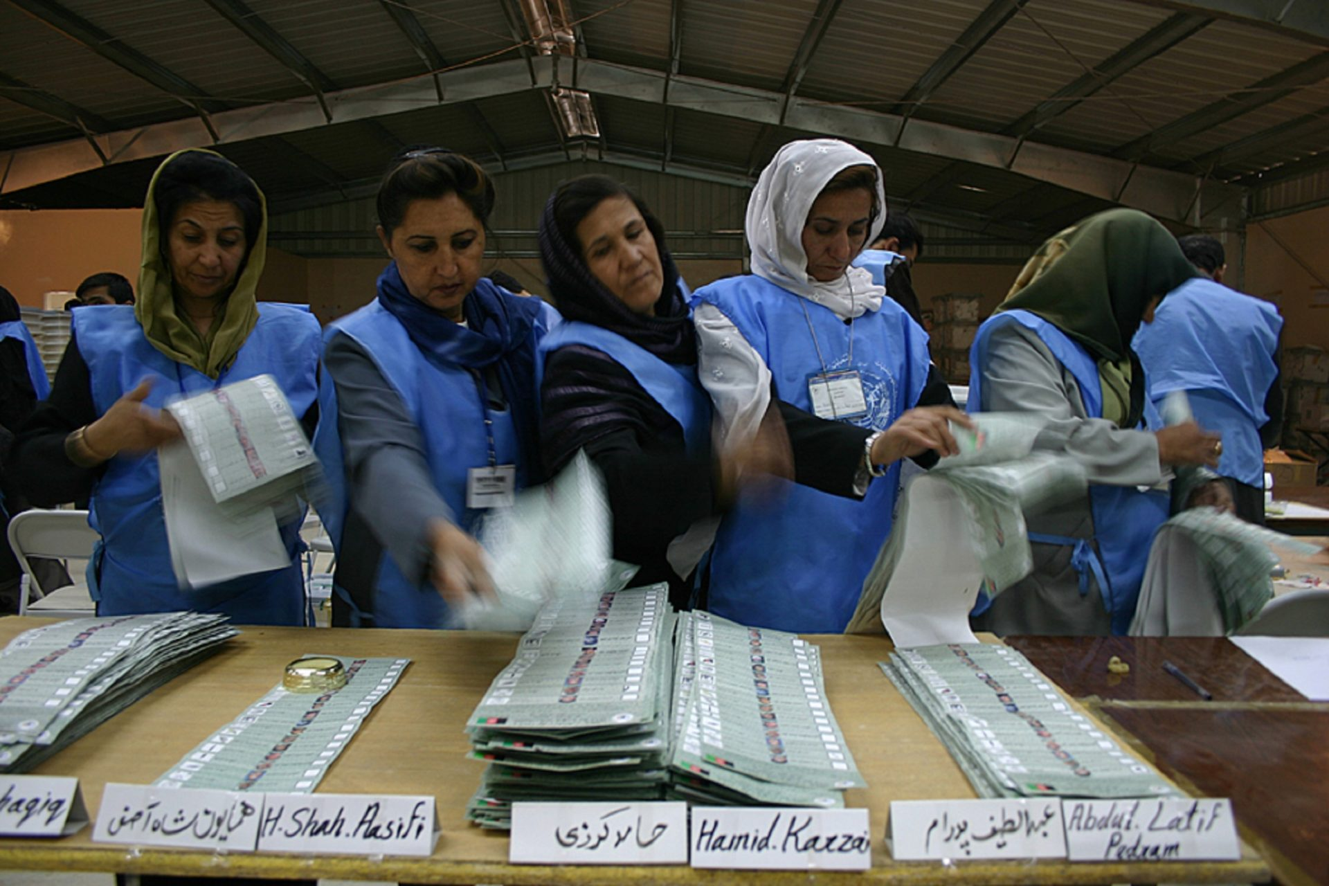 """In the Darulaman's Counting centre, in Kabul, nine days after the first direct presidential election, October 9, the UN-Afghan JEMB's (Joint Electoral Management Body) employees sort out the ballot papers per candidate from Kabul. Then, the total votes for each candidate are counted and recorded. This operation is called """"sorting and counting"""". Among the 10.5 million Afghans registered for the elections, around 8 million people have voted according the first estimations made one week after the vote."""